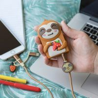 Lifestyle photo of a cute sloth shape 2000mAh powerbank around 2.5 inches in size